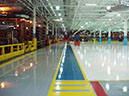 High bay painting using dry fall coating and 2 coat 100% solids epoxy flooring with aisle markings and walkways